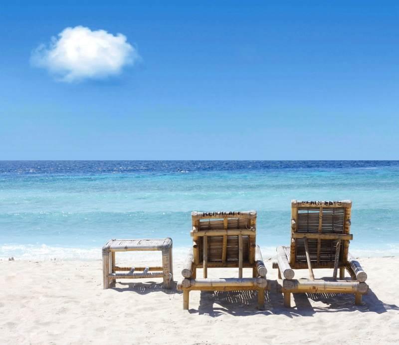 Sommerferien er sikret. Vil man for eksempel gerne holde tre ugers sommerferie i år, kan det sagtens lade sig gøre. Det svarer nemlig til 15 feriedage, og man vil dermed have 1,64 feriedage i overskud. Foto: Colourbox